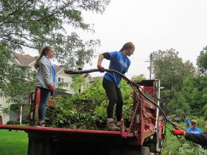 Students filled a village dump truck with limbs, vines and other debris.