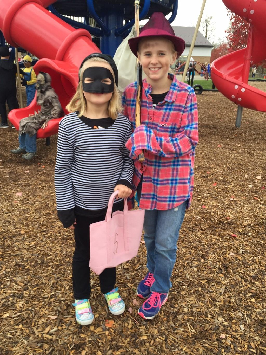 girl in mask with boy dressed in country gear