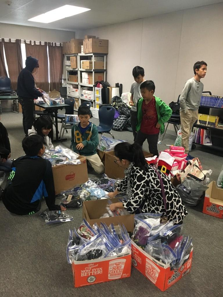 Students sorting through boxes.