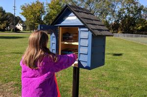 A student looks inside the little library.