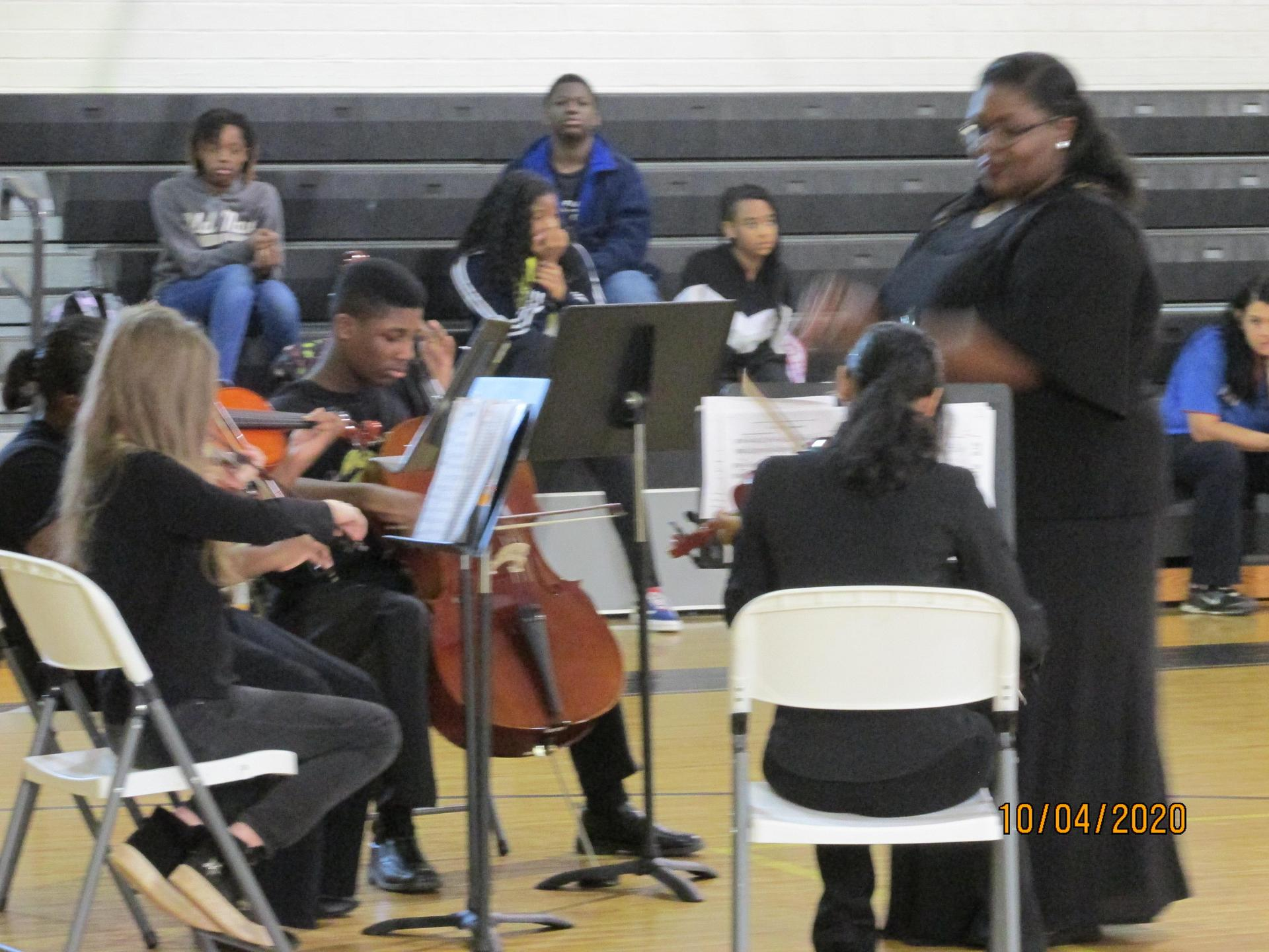 Ms. Wise and the Orchestra students performing