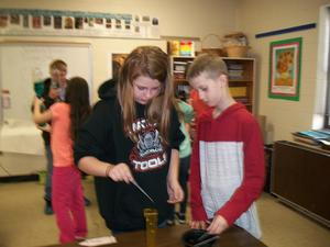 Students participate in science experiments.