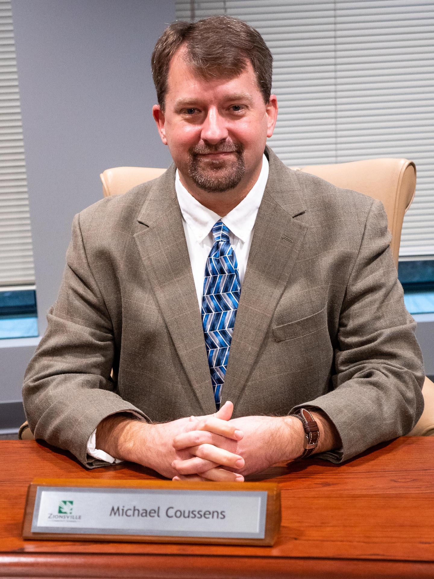 Mr. Michael Coussens
