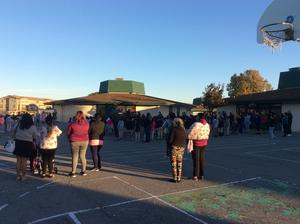 Parents and students gathered on blacktop for assembly, image 1