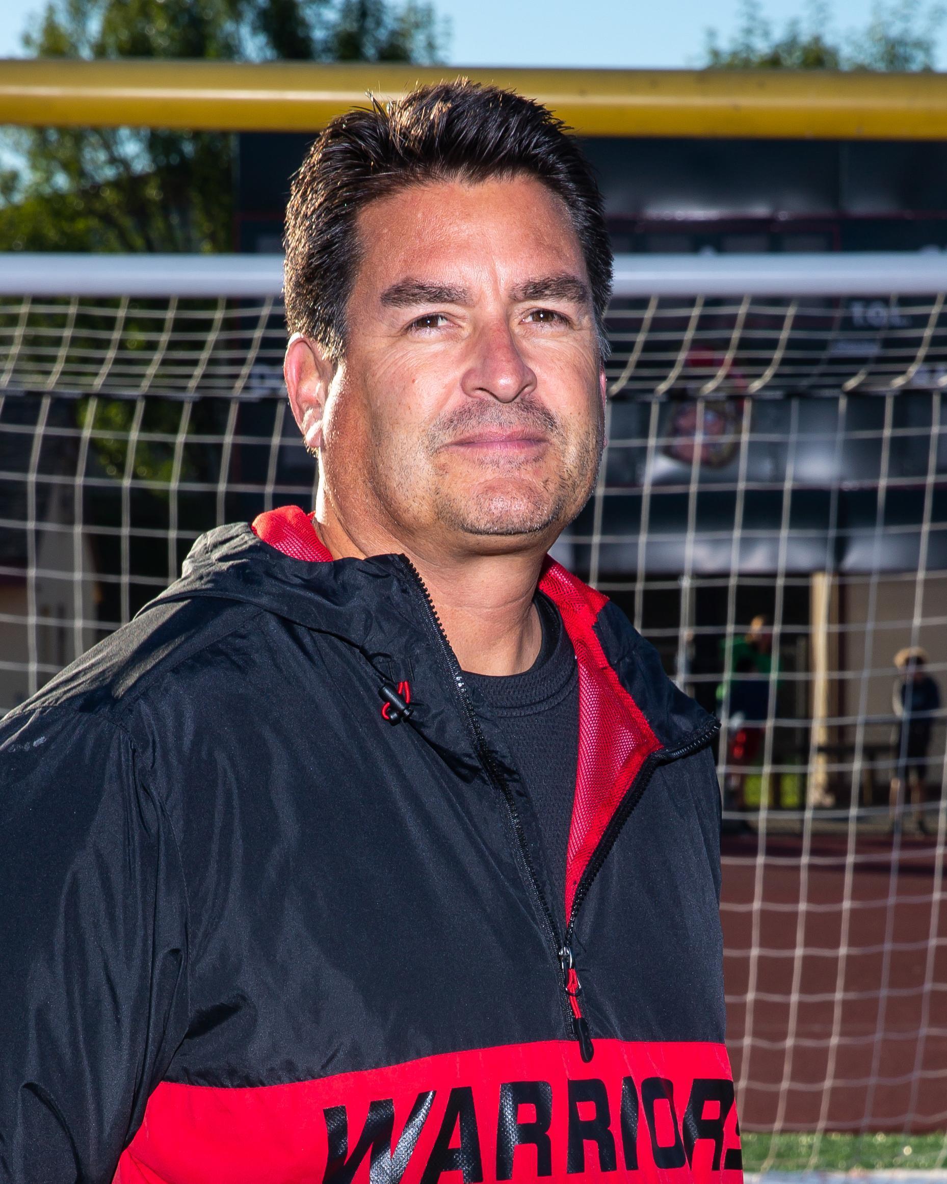 Head Varsity Coach, Scott Hughes