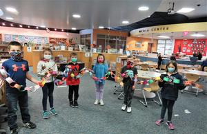 Lee students created a paper chain with each link having a student pledge to help make the world a better place.