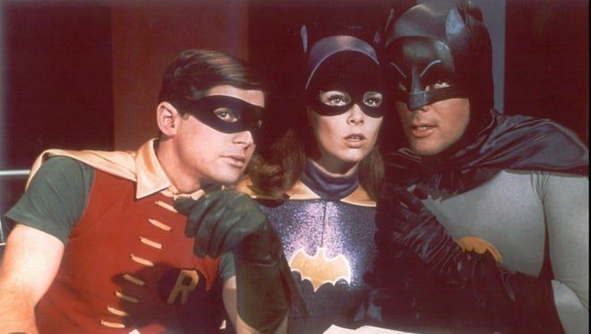 BATMAN, Robin, and Batgirl talking to each other
