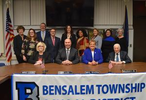 2019-20 Bensalem School Board Directors, along with the District Superintendent, Asst. Superintendent, and Board secretary and Solicitor posed next to the American Flag. There are 9 woman and 4 men.