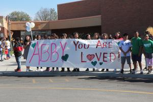 Banner held by crowd supporting Abby