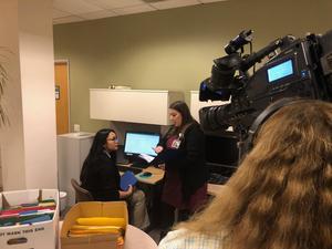 Jess being filmed at her desk
