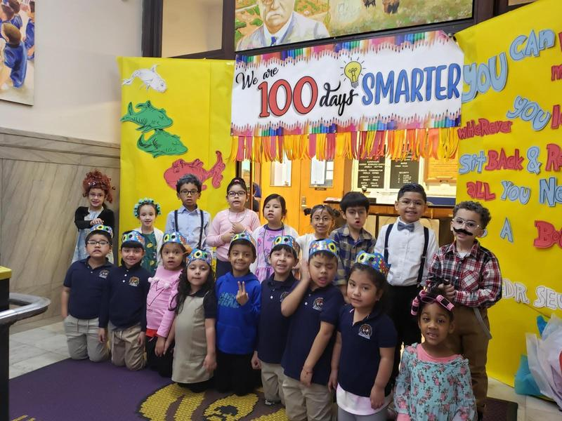 class in front of the 100 days smarter display dressed as old people