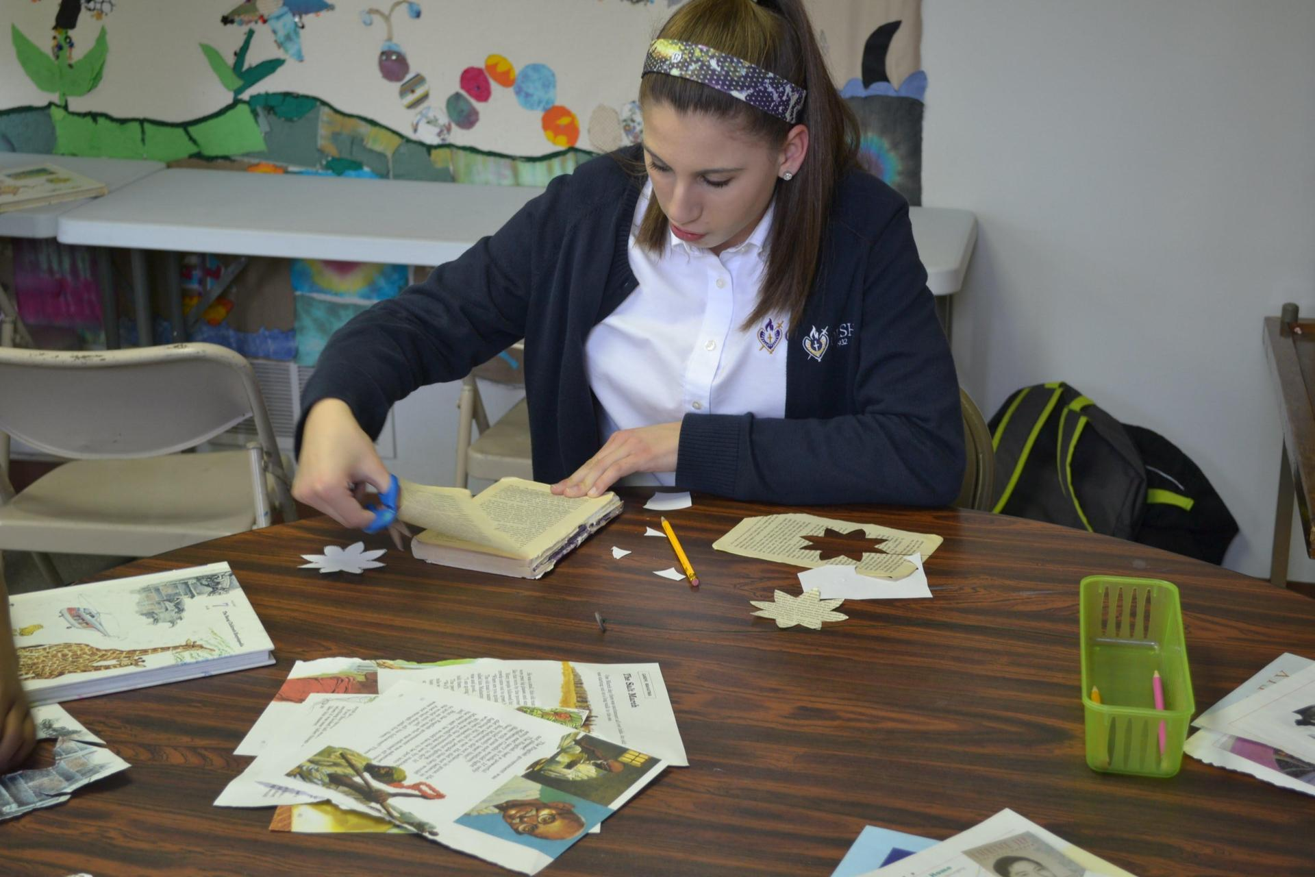 Francesca volunteering at the Mooncrest After School Program, helping the children make paper flowers during National Catholic Sisters Week last year.