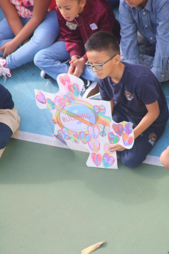 boy holding anti-bullying puzzle piece