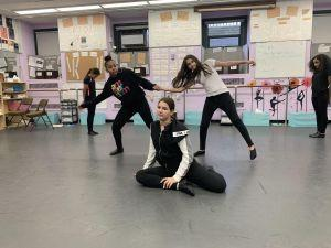 Students stretching in schools' dance room