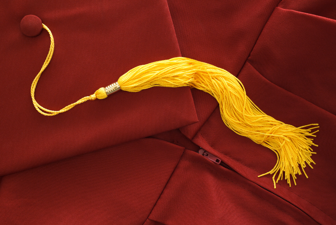 maroon cap and gown