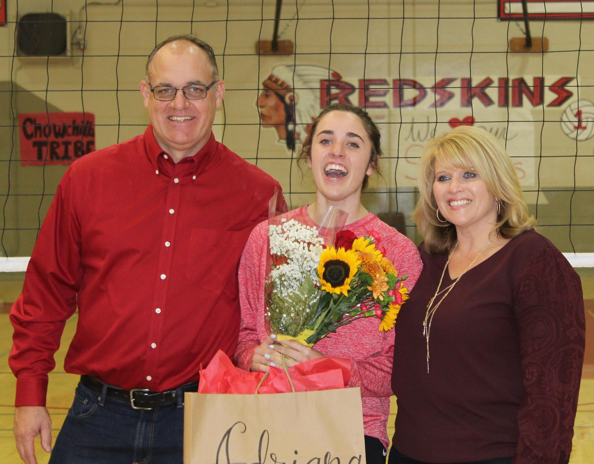 Adrianna Felsinger and her parents on Volleyball Senior Night.