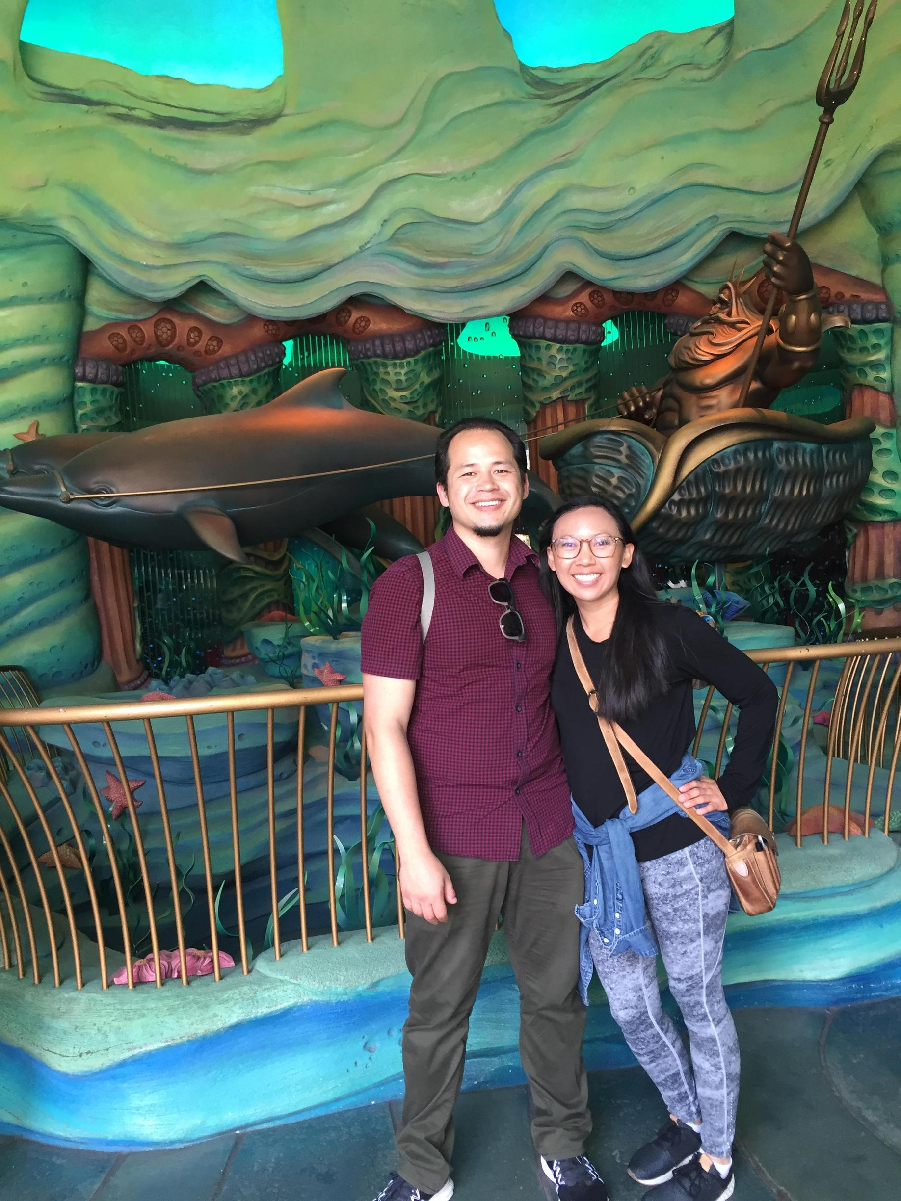 Mrs. and Mr. Palmer hanging out in front of a Little Mermaid set at Disney Sea Resort in Tokyo, Japan.