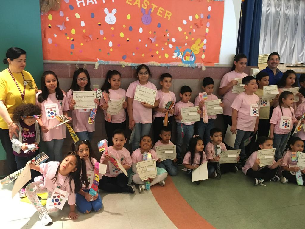 Mrs. Michael's class with Mr. Celebrano showing off their participation certificates