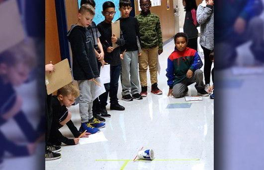 Students learning with roller cars