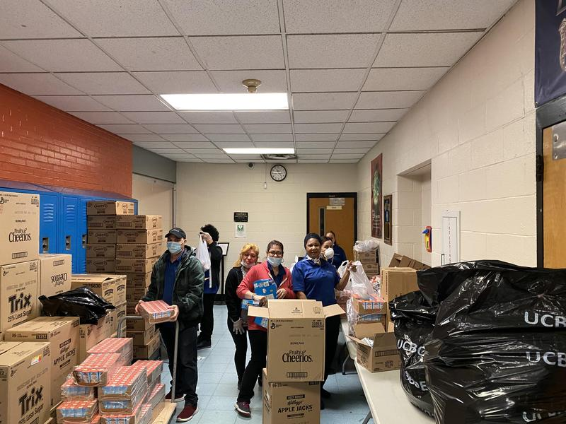 volunteers getting the food packets together for the students