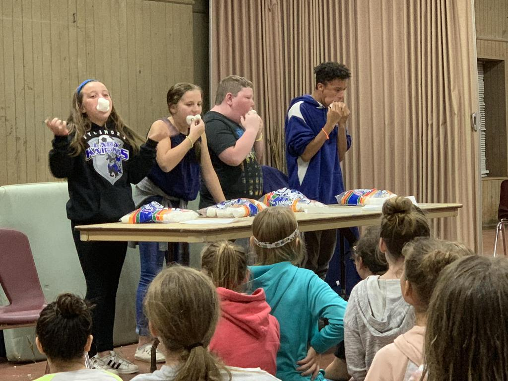 Students eating marshmallows