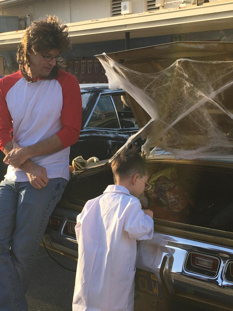 child looking at candy in trunk