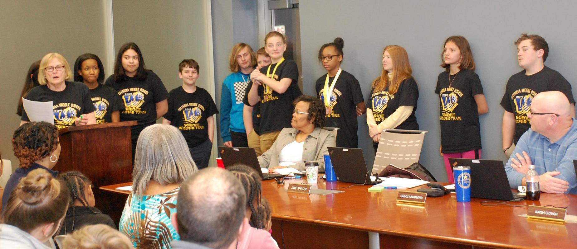 Science Olympiad students at board meeting