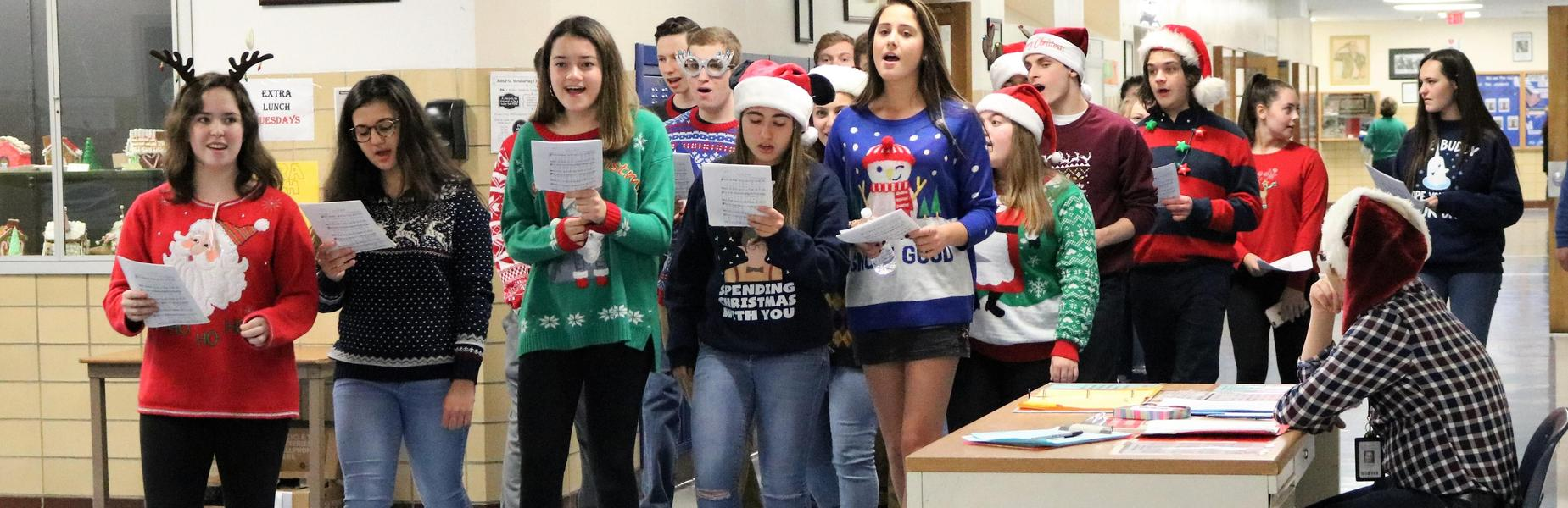The Westfield High School Chorale takes to the hallway to sing carols to staff and students.