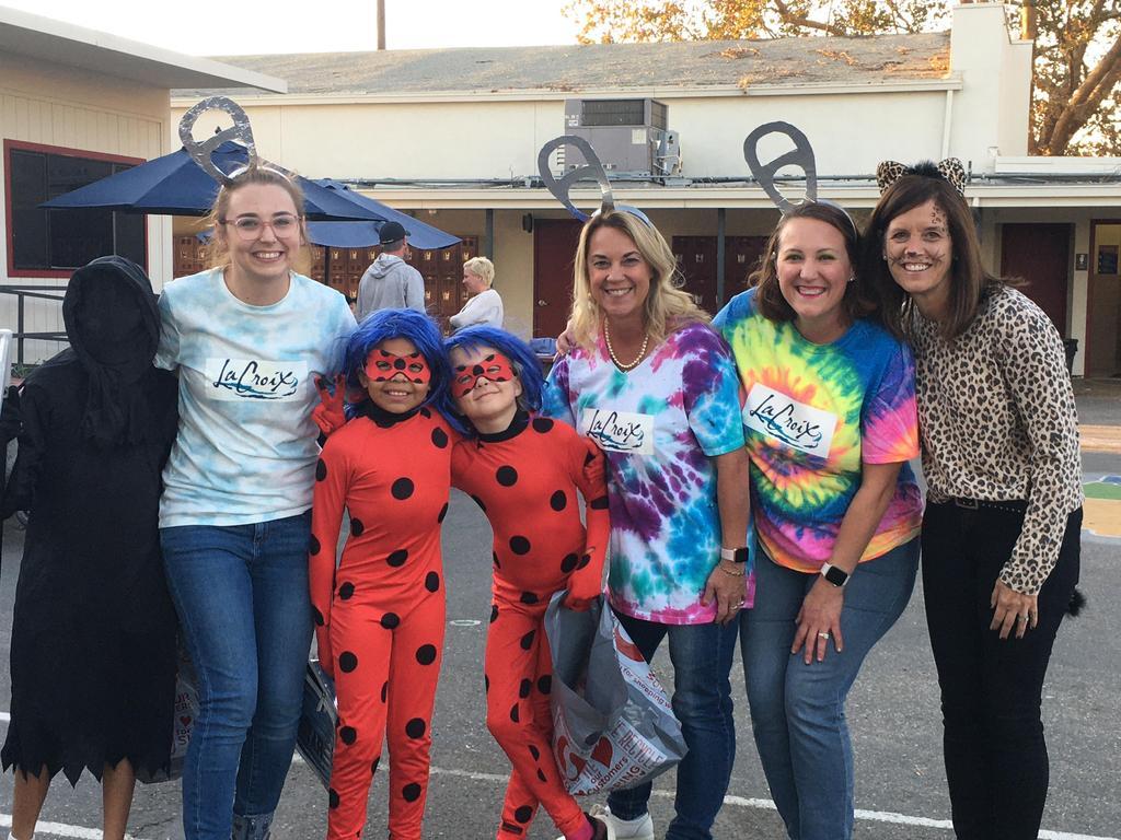 teachers, principal and kids dressed up for halloween