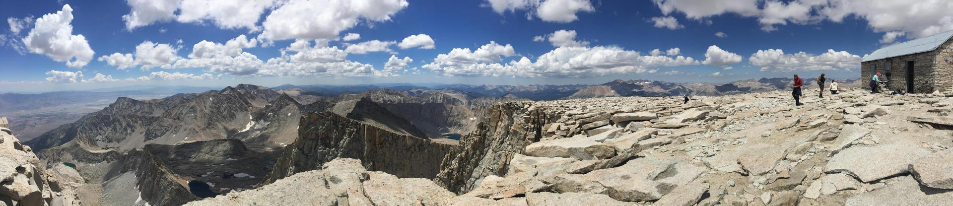 Panoramic View of Mt. Whitney's summit with Hikers and summit hut.