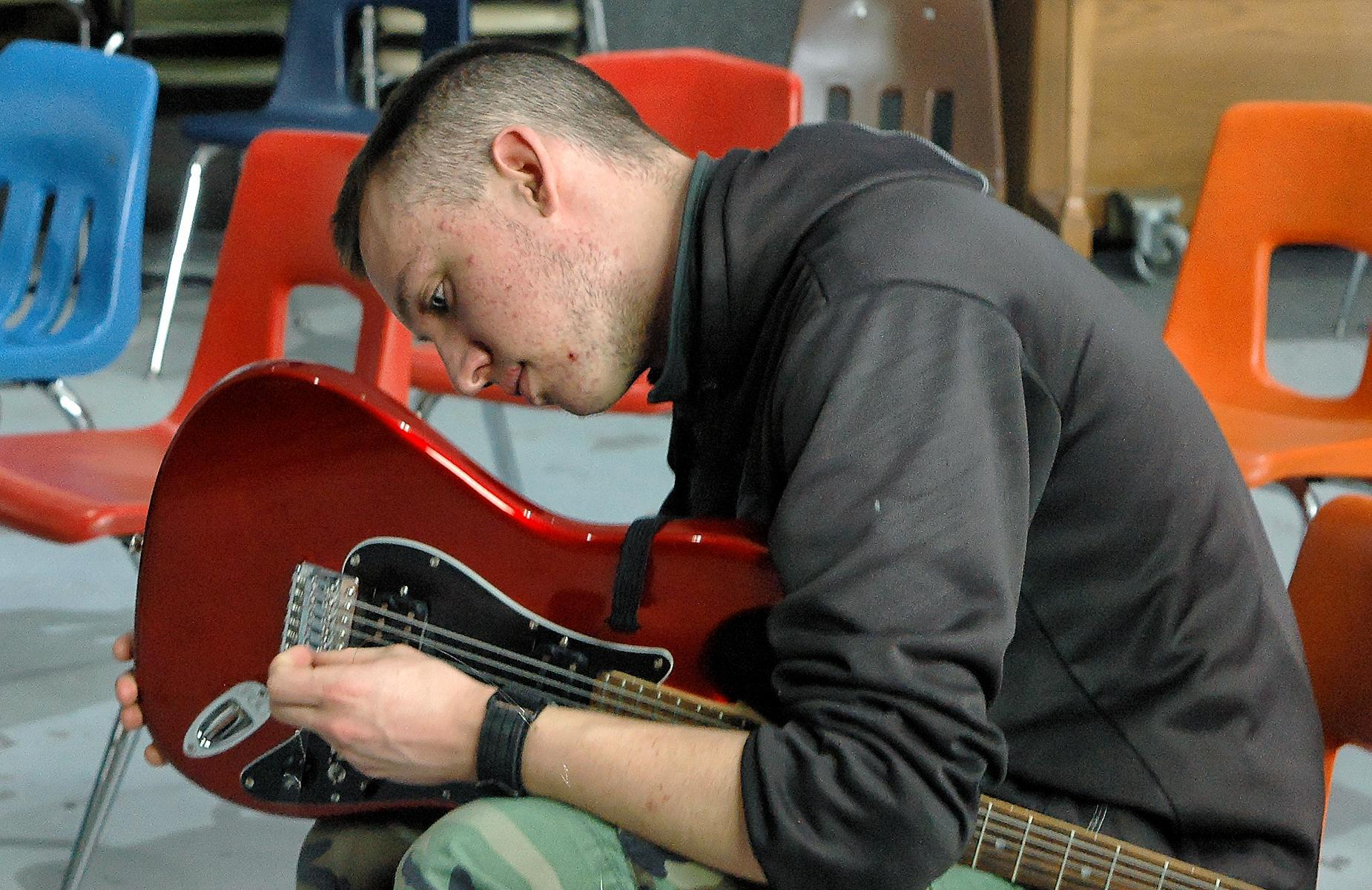 Student working on a guitar