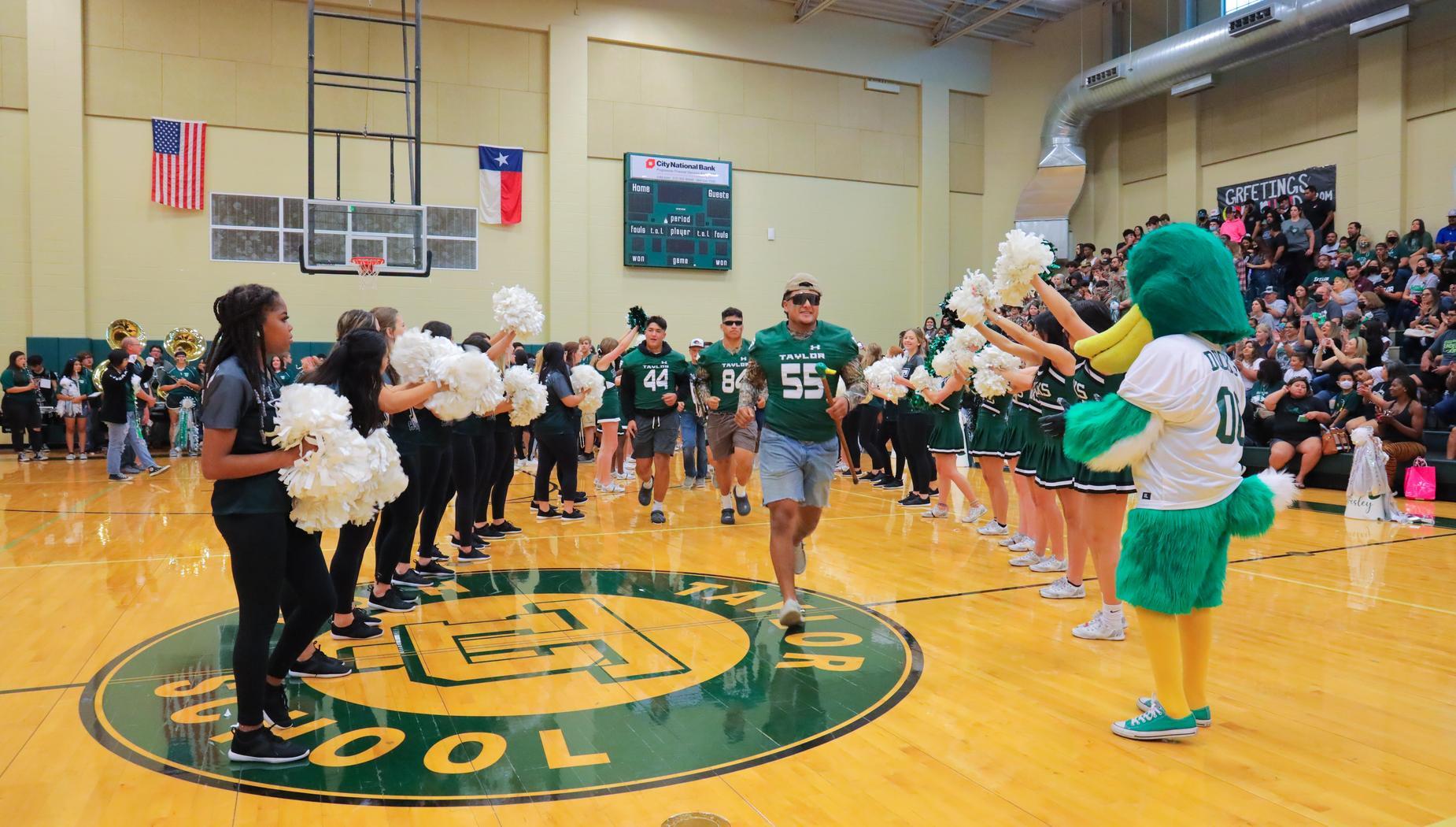 Football Team enters pep rally