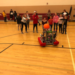 Students with a robot