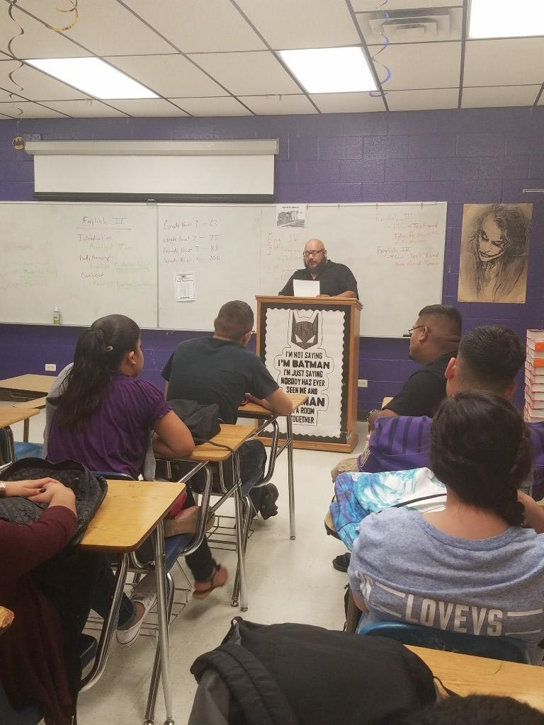Mr. Serna reading a poem in front of the class.