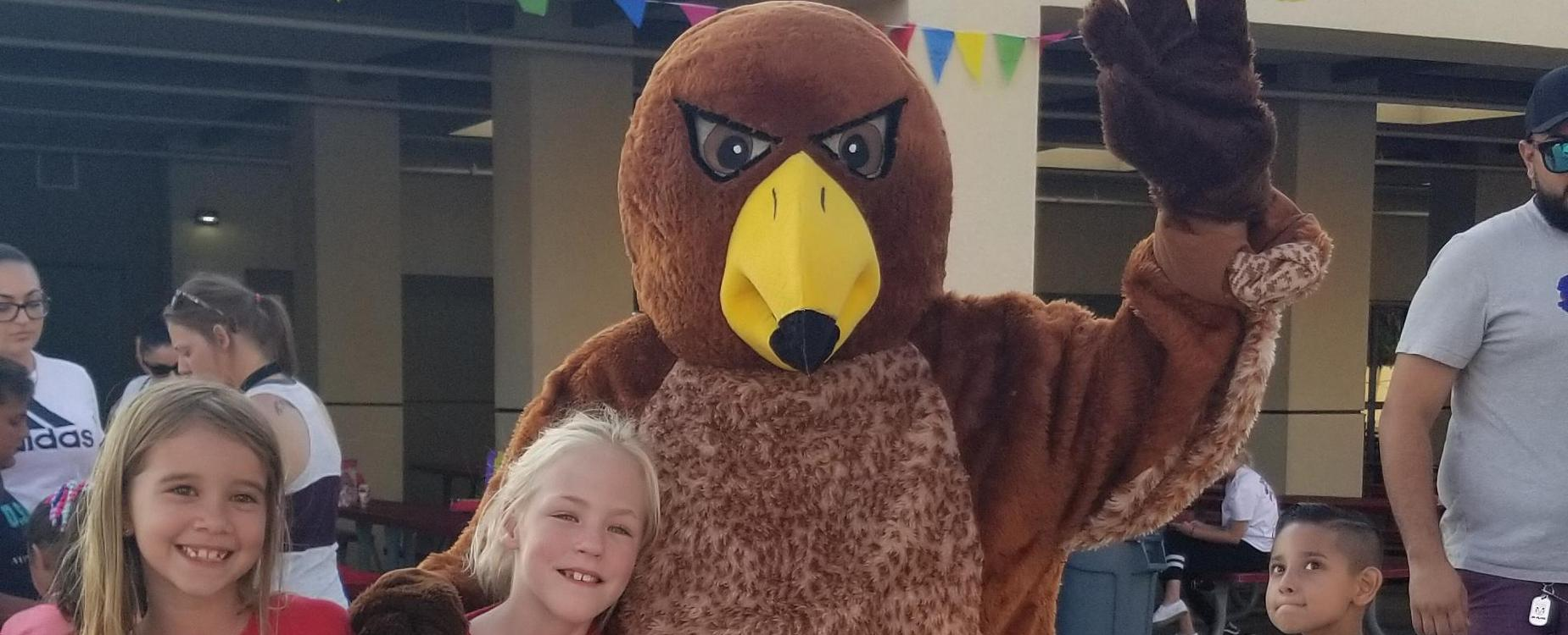picture of students with the hawk