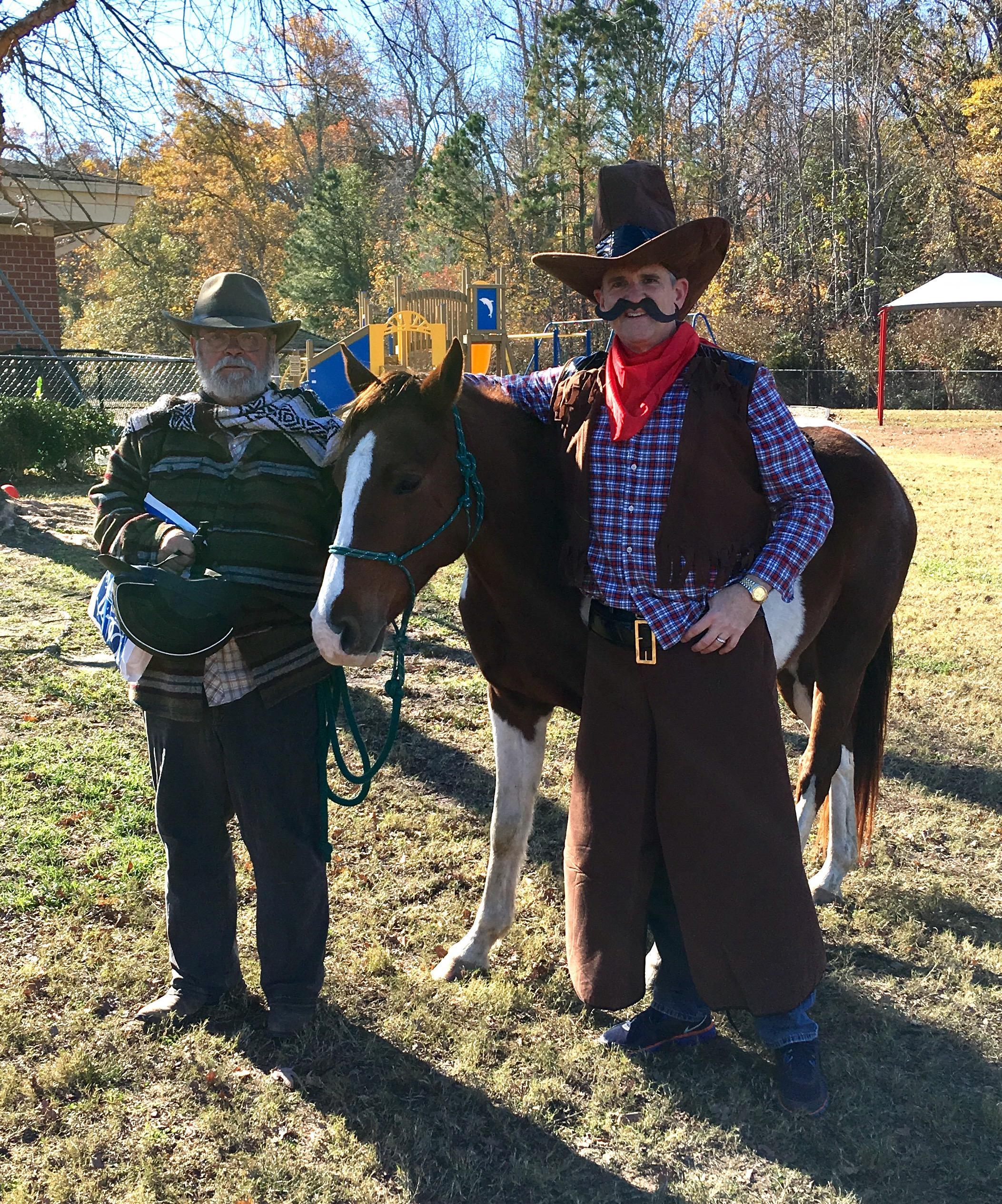 mr. brennan dressed as a cowboy with a horse
