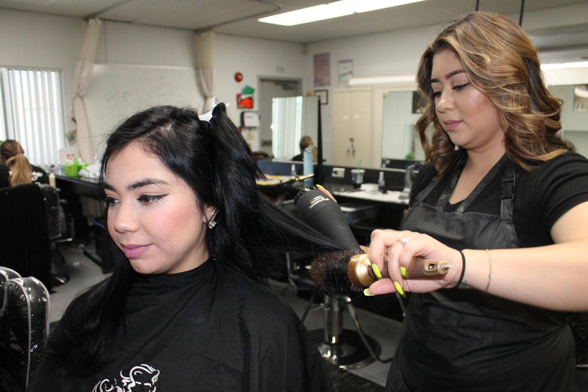 Cosmetology Student Blow Drying Hair