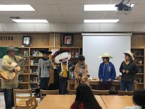 Students modeling historical headwear