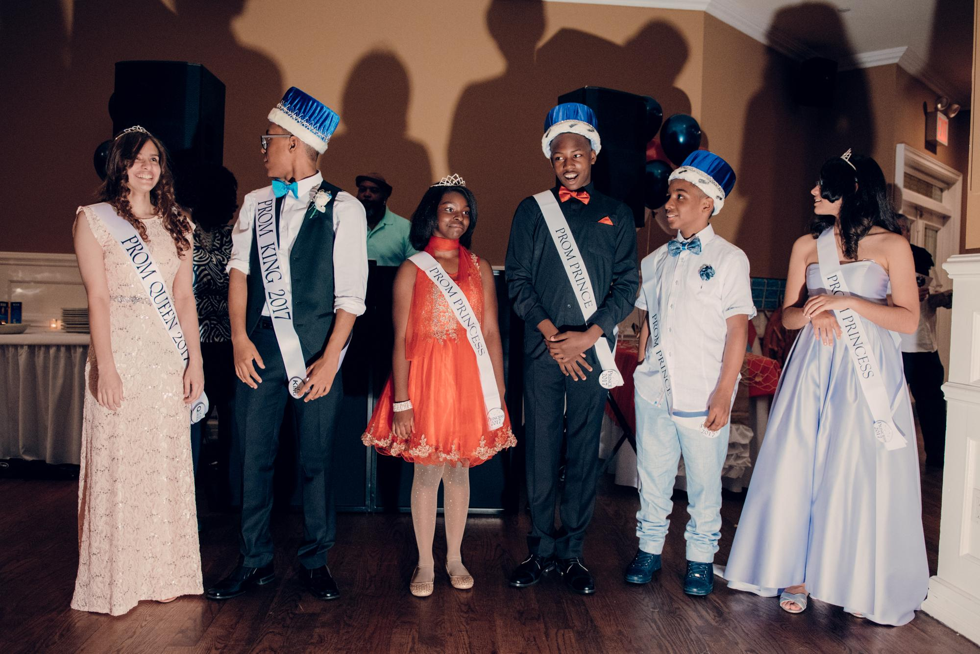 The prom king and queen with their court of 2 princesses and princes