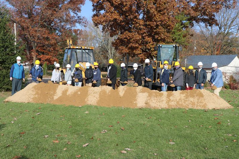 school leaders, sun funded representatives and students help shovel dirt at the groundbreaking
