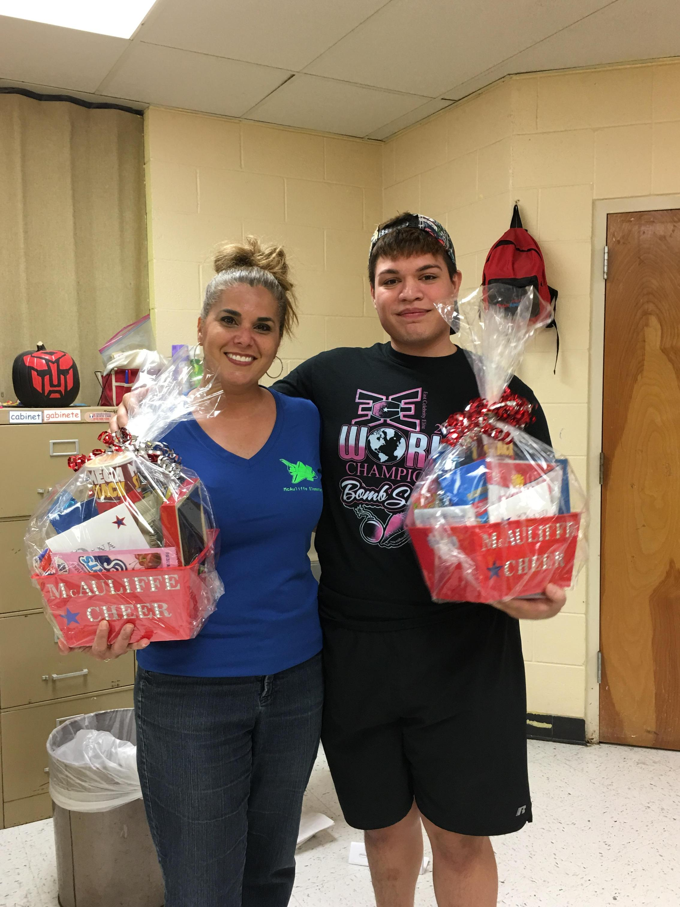 Cheer coaches with goody basket.