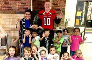 TTU Athlete with Students