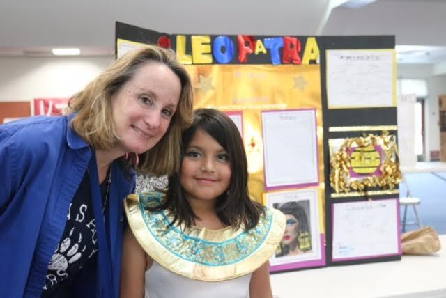 Principal Dr. Groth with a student during the wax museum.
