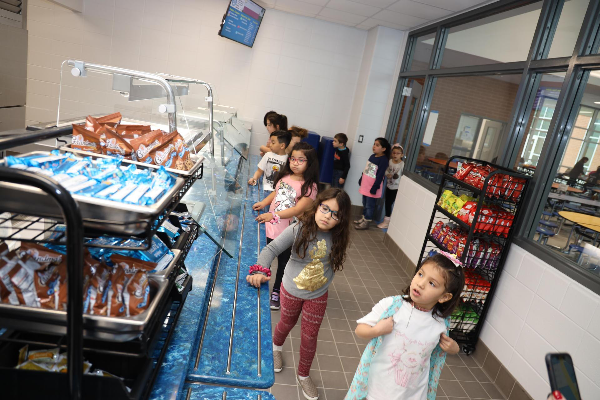 Carpenter Elementary students celebrate the opening of their new school