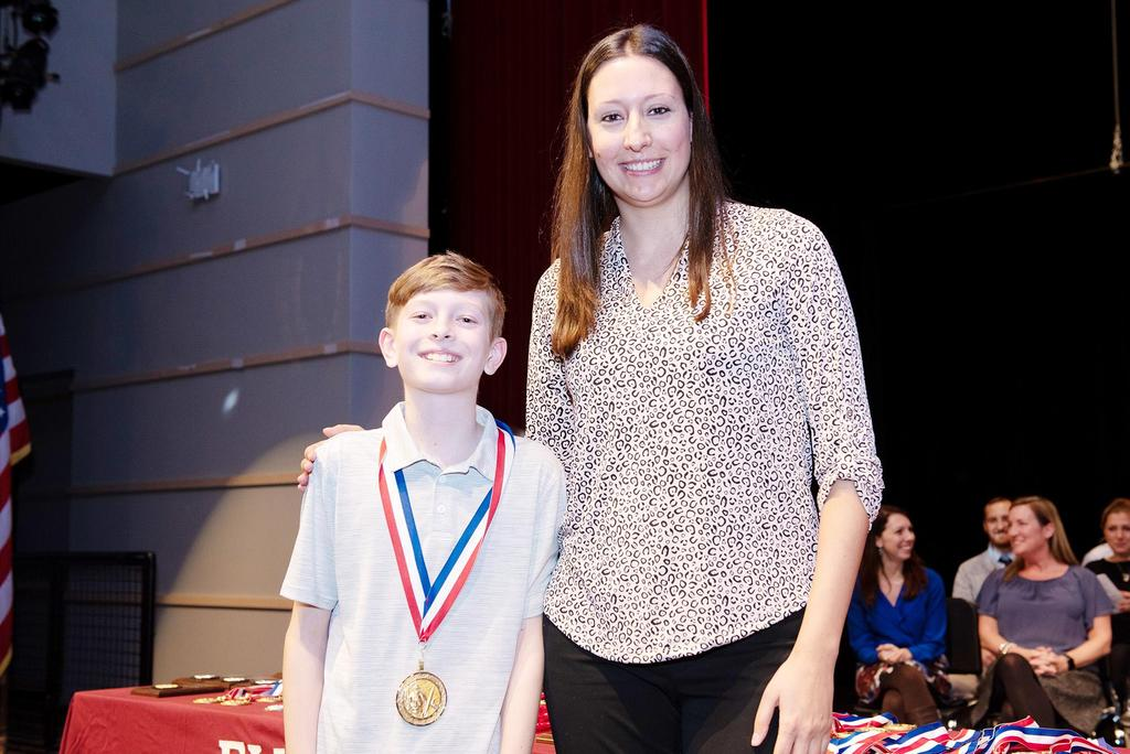 Teacher Christina Moreira and sixth-grade gold-medal winner Jason Spaulding