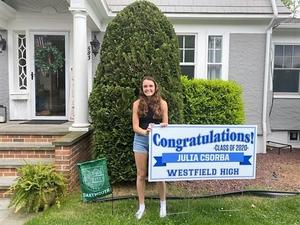 Photo of WHS senior with lawn sign.