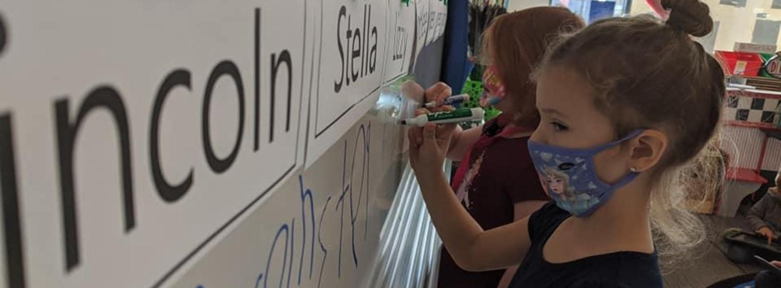 students write names on board