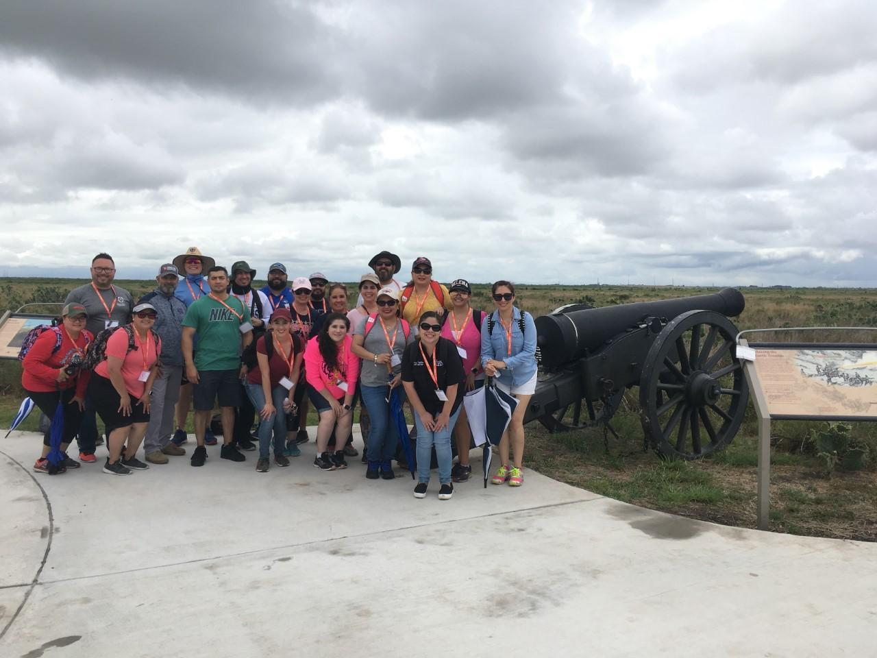Group photo in front of cannons