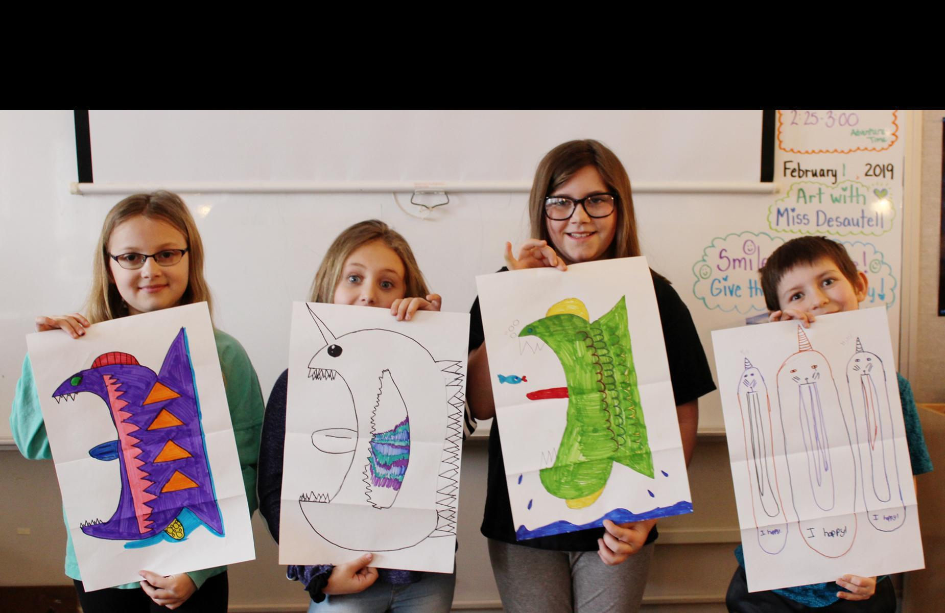 Fuller kids with fish drawings