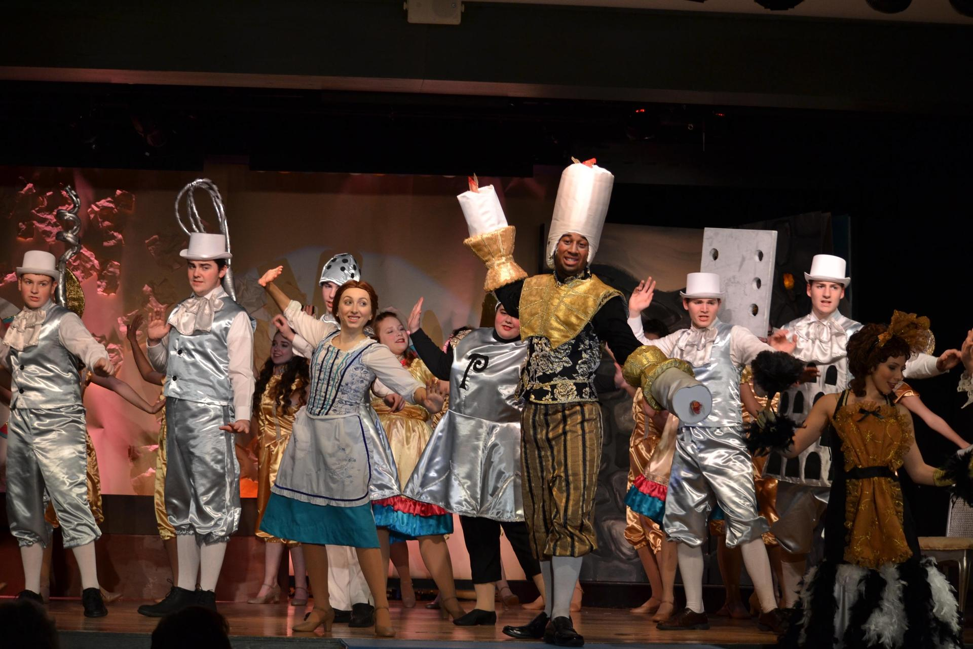 Lumiere played by Dom, leads the cast of the spring musical in 'Be Our Guest'